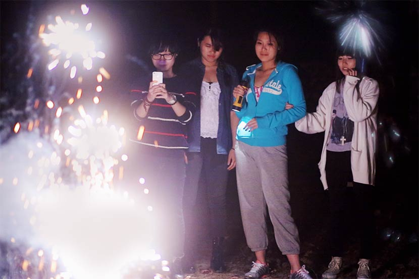 A still from the documentary 'Maineland' shows Stella (second from right) with a group of friends in the U.S. Courtesy of Wang Miao